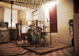 Studio K61's main recording room with microphones at drum-kit and guitar amp