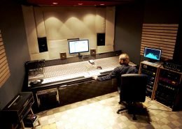 Sound Engineer working in mixing studio at analog mixing console ADT 5mt
